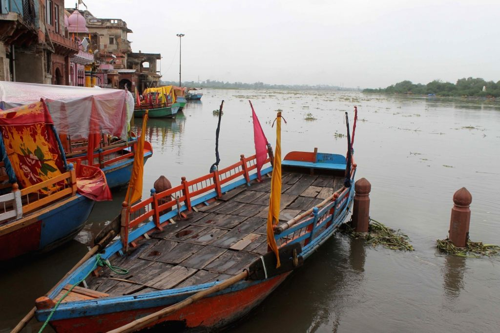 Mathura: A view of swollen Yamuna river after a heavy rainfall in Mathura on July 21, 2016. (Photo:IANS)