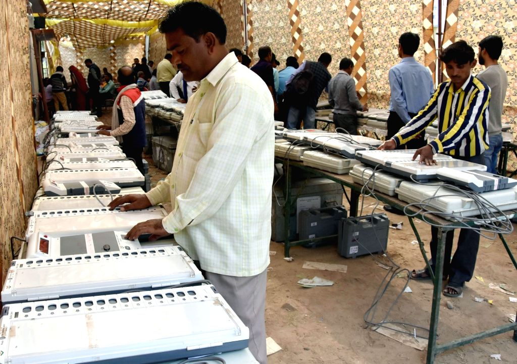 : Mathura: Candidates check EVMs ahead of the municipal elections in Mathura on Nov 15, 2017. (Photo: IANS).