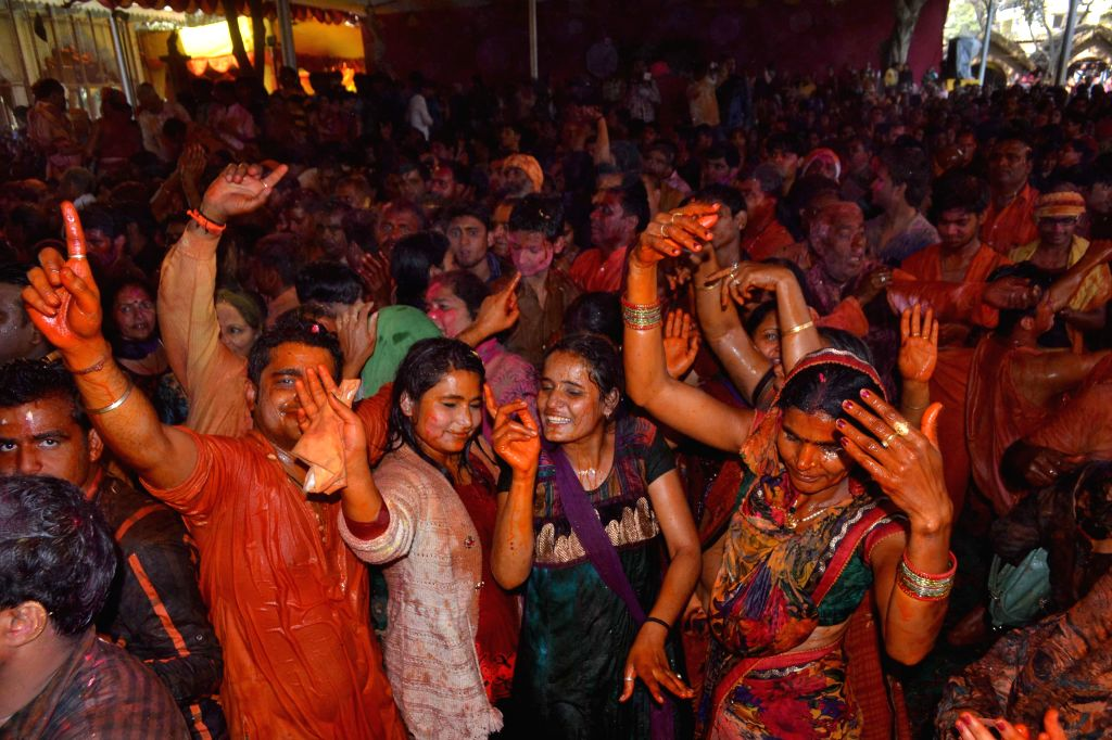 People celebrate Holi - festival of colours in Gokul, Mathura on Feb 22, 2015.