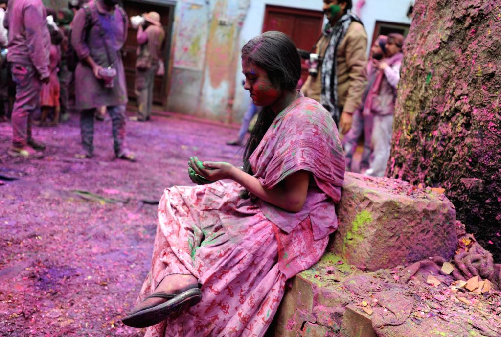 People celebrate Holi in Vrindavan of Uttar Pradesh's Mathura district  on March 3, 2015.
