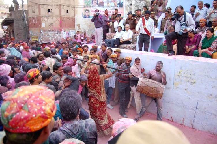 People participate in `Lathmaar Holi` in  Barsana of Uttar Pradesh's Mathura district, on Feb 27, 2015.