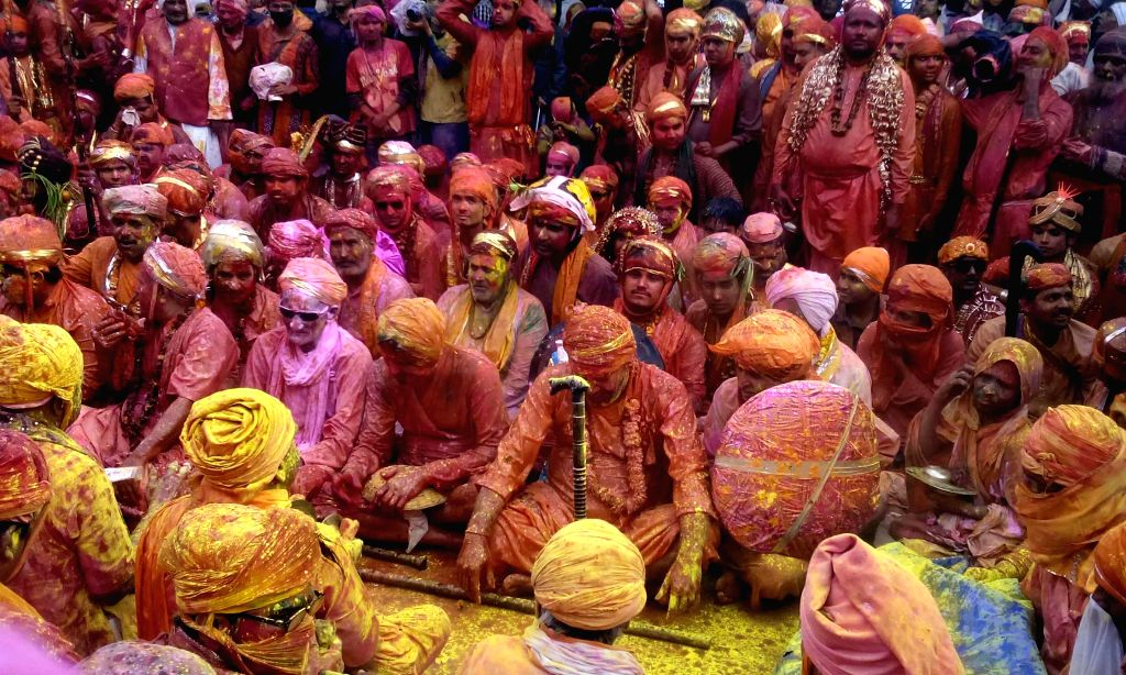 People play holi at the Nandgaon Temple in Mathura district of Uttar Pradesh on Feb 28, 2015.