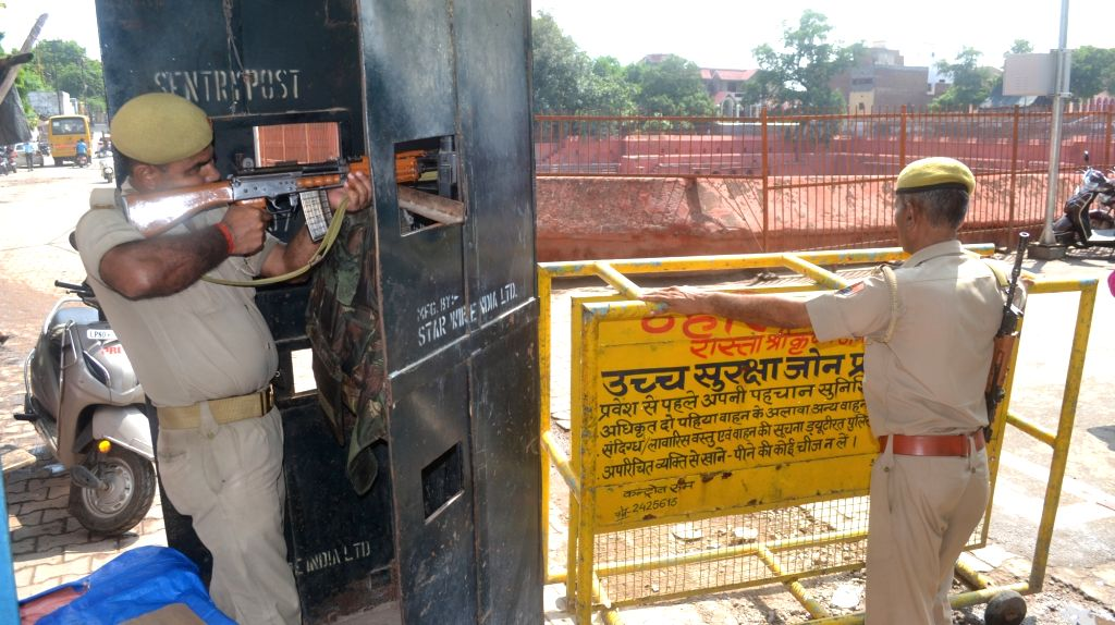 Mathura: Security beefed up outside Krishna Janamasthan Temple after an auto-rickshaw driver's mobile phone was allegedly used by a tourist to make calls threatening to blow up temples, in Mathura on Aug 9, 2019. The mobile phone was used by the tour