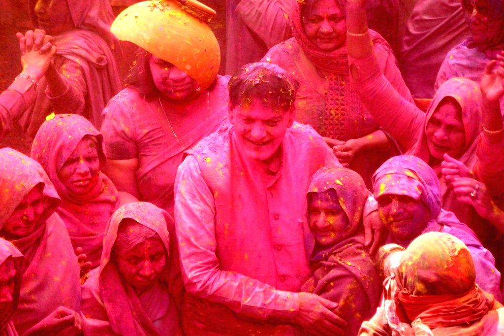 Social worker and Sulabh International founder Bindeshwar Pathak  celebrates Holi with widows in Vrindavan of Uttar Pradesh's Mathura district  on March 3, 2015. - Bindeshwar Pathak