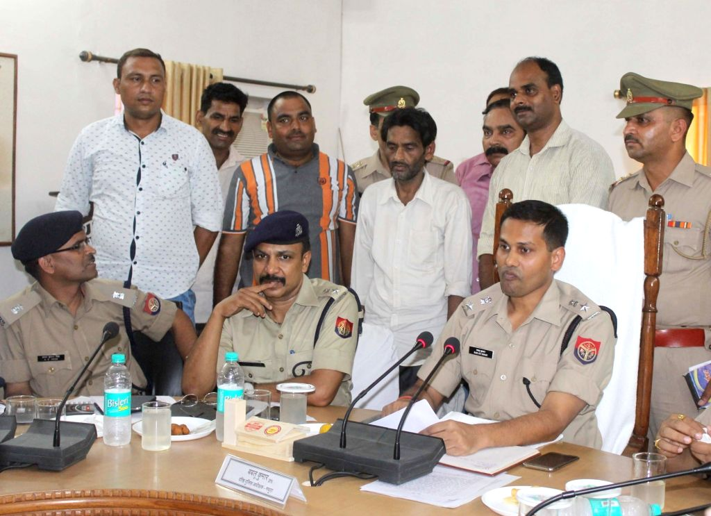 Mathura SSP Babloo Kumar presents before press Viresh Yadav one of the accused in Jawaharbagh violence case in Mathura on June 29, 2016. - Babloo Kumar and Viresh Yadav