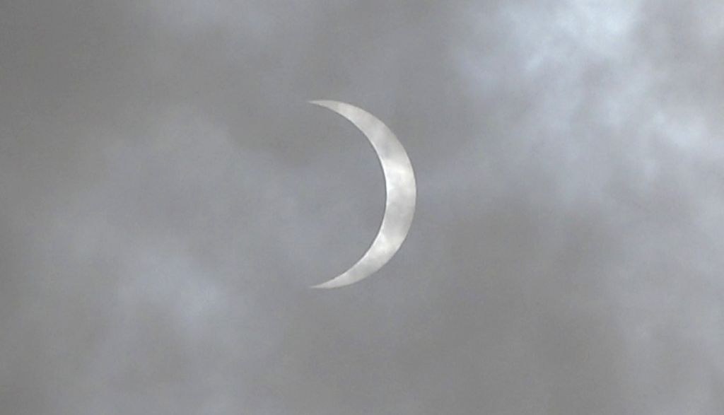 """Mathura: The """"ring of fire"""" solar eclipse unfolds in the partially cloudy skies of Mathura on June 21, 2020. A solar eclipse occurs on a new moon day when it comes in between the earth and the sun and all the three objects are aligned. An annular sol"""