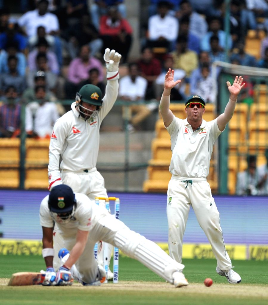 Matthew Wade and David Warner of Australia appeal for a wicket during the third day of the second test match between India and Australia at M. Chinnaswamy Stadium in Bengaluru on March 6, ...