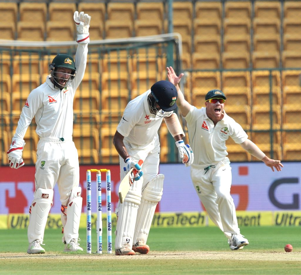 Matthew Wade and David Warner of Australia appeal for a wicket during the fourth day of the second test match between India and Australia at M. Chinnaswamy Stadium in Bengaluru on March ...