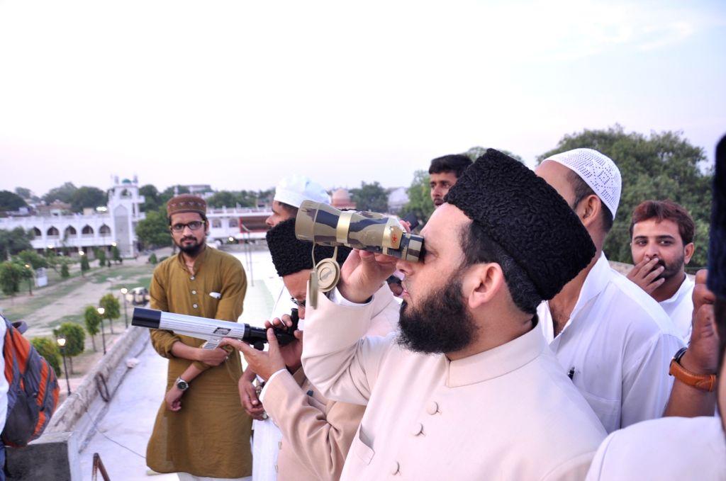 Maulana Khalid Rasheed Farangi Mahli, the chief cleric of Lucknow's Aishbagh Eidgah looks for crescent moon in Lucknow on June 25, 2017.