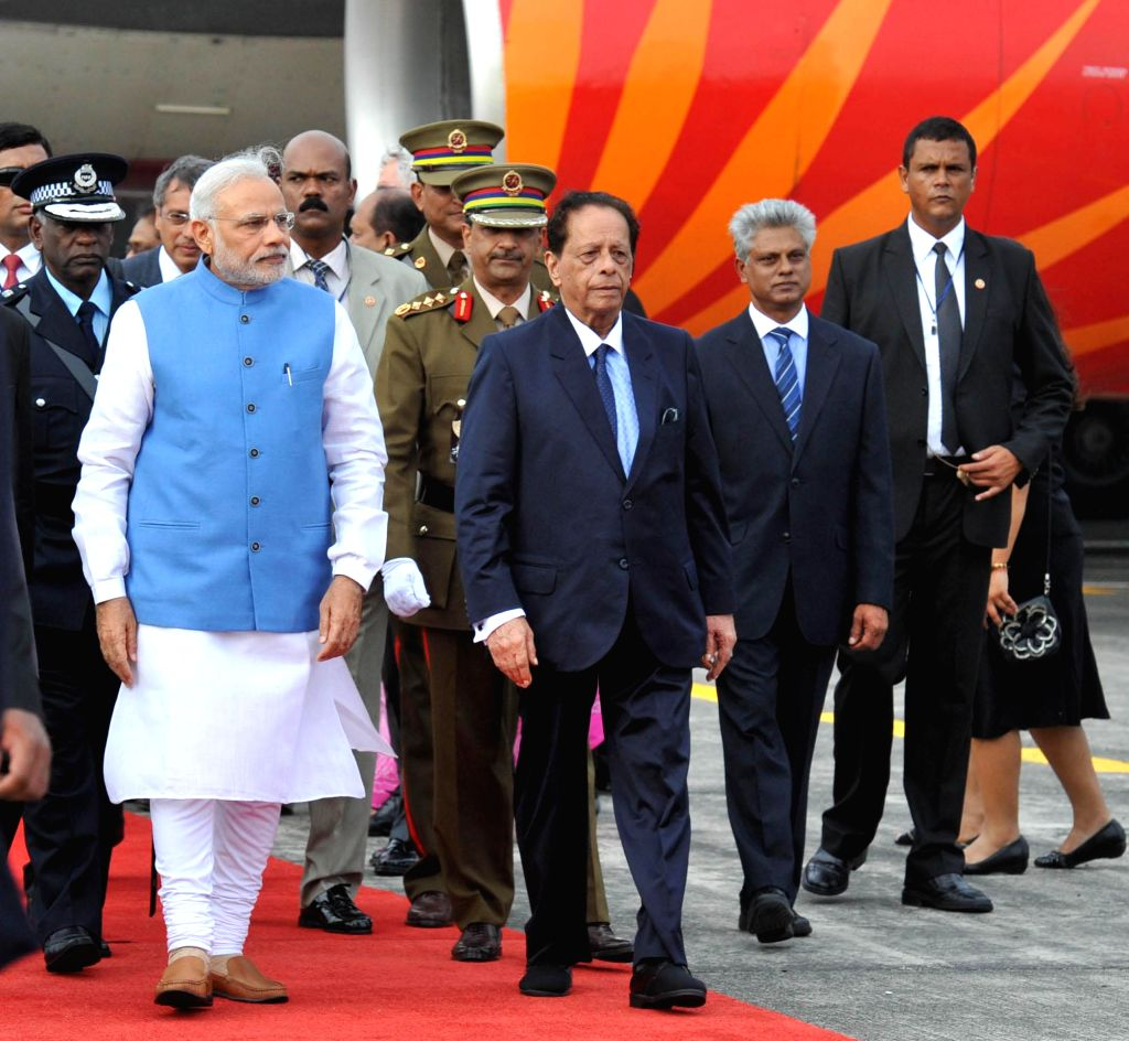 Prime Minister Narendra Modi arrives at Sir Seewoosagar Ramgoolam Airport, in Mauritius on March 11, 2015. - Narendra Modi