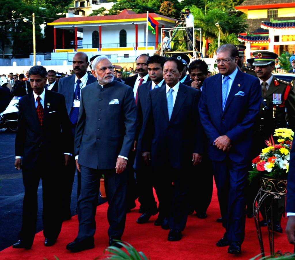 Prime Minister Narendra Modi attends the National Day celebrations in Mauritius on March 12, 2015. Also seen Prime Minister of Mauritius, Sir Anerood Jugnauth. - Narendra Modi