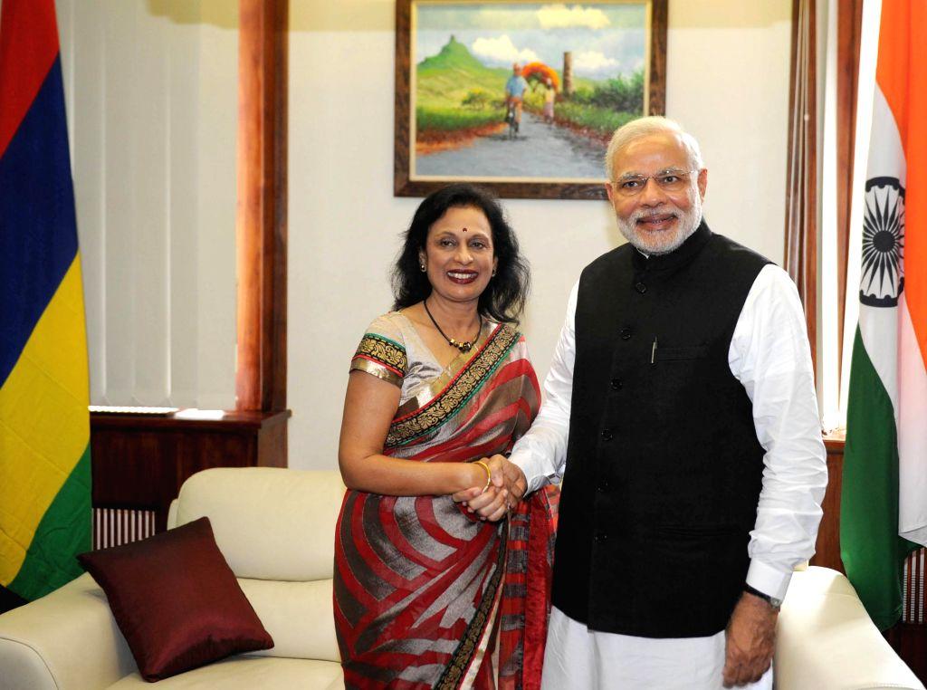 Prime Minister Narendra Modi meets the Speaker of Mauritius Santi Bai Hanoomanjee, in Mauritius on March 12 2015. - Narendra Modi