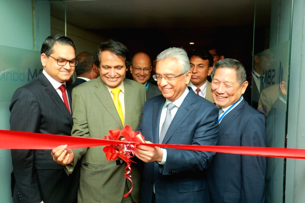 Mauritius Prime Minister P.K. Jugnauth and Union Commerce and Industry and Civil Aviation Minister Suresh Prabhu inaugurate the SBM Bank (India) Ltd in Mumbai, on Jan 25, 2019. SBM Bank ... - P. and Suresh Prabhu