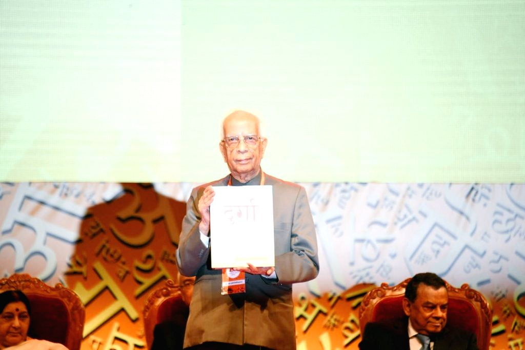 "Mauritius: West Bengal Governor Keshari Nath Tripathi launches ""Durga"" magazine during the '11th Vishwa Hindi Sammelan', in Mauritius on Aug 18, 2018. (Photo: IANS/MEA) - Keshari Nath Tripathi"