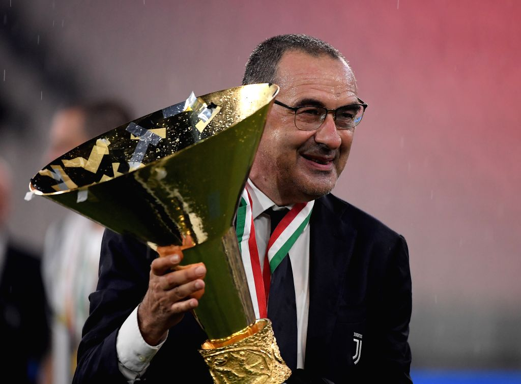 Maurizio Sarri, head coach of FC Juventus, poses with the trophy at the end of the Serie A football match between FC Juventus and Roma in Turin, Italy, Aug 1, 2020.