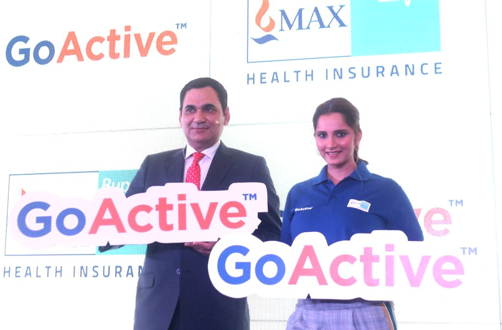 Max Bupa MD and CEO Ashish Mehrotra and tennis player Sania Mirza during the launch of a health insurance plan in New Delhi on Feb 13, 2018. - Sania Mirza