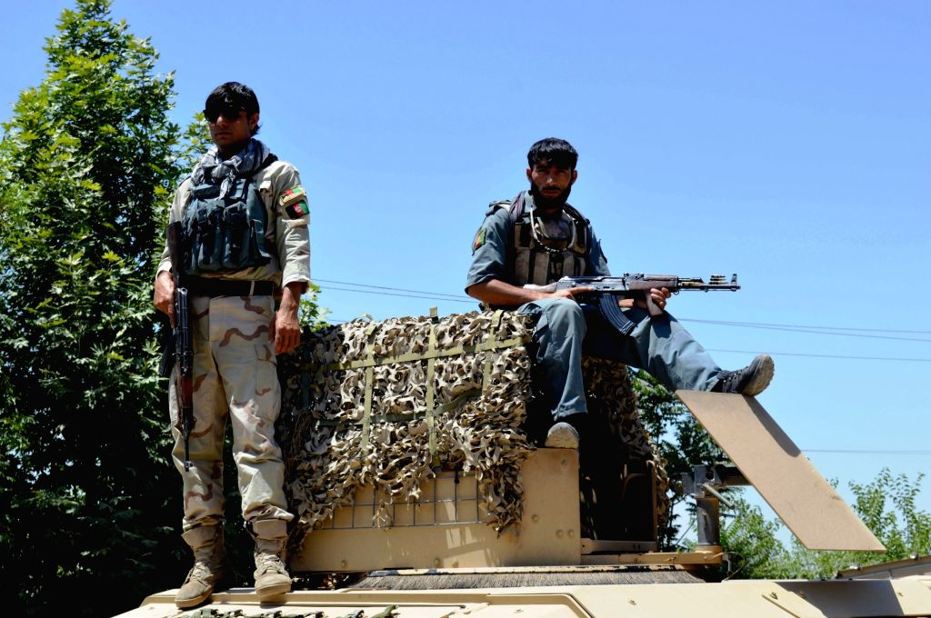 , May 31, 2016   Afghan security personnel stand at the site of kidnapping in Kunduz province, Afghanistan, May 31, 2016. The Taliban militants on Tuesday intercepted three ...
