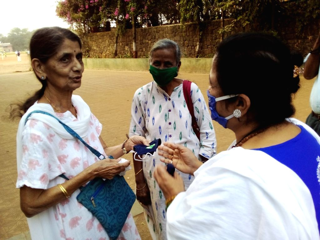 Mayor Kishori Pednekar distributes masks to the people without masks at Shivaji Park, Dadar in Mumbai on Saturday 20th February, 2021.