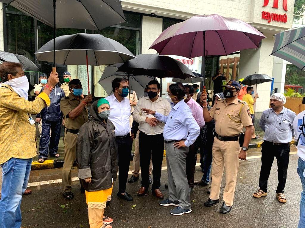Mayor Kishori Pednekar, Mumbai South Shiv Sena MP Arvind Sawant, Additional Municipal Commissioner Sanjeev Jaiswal and other senior officials inspect the site after a minor landslide occurred ...