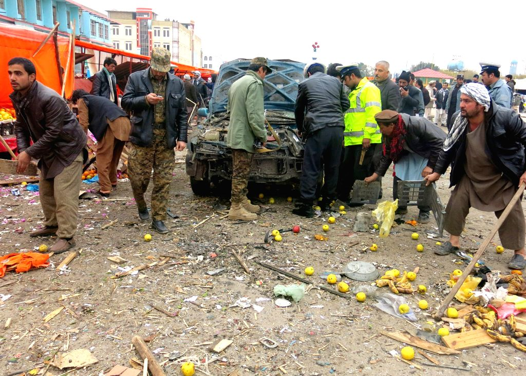 Mazar (Afghanistan): Afghan security forces inspect the site of blast in Mazar province in northern Afghanistan, Nov. 28, 2014. Three civilians were injured as a bomb blast rocked a bazaar Friday in .