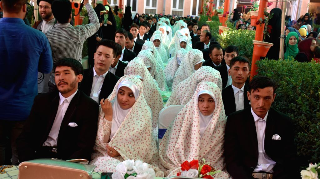 MAZAR-E-Afghan brides and grooms attend a wedding ceremony in Mazar-e-Sharif, Afghanistan, Sept. 19, 2016. A mass wedding ceremony was held Monday with the ...