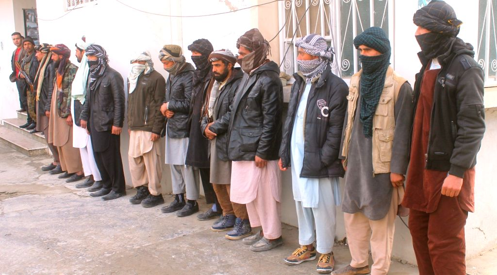 MAZAR-E-Taliban fighters attend a surrender ceremony in Mazar-e-Sharif, capital of northern Balkh province, Afghanistan, Jan. 18, 2016. About 15 Taliban fighters ...