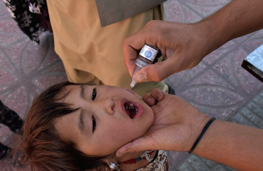 MAZAR-I-A health worker gives a polio vaccine to a child during a vaccination campaign in Mazar-i-Sharif, capital of northern Balkh province, Afghanistan, Sept. 15, ...