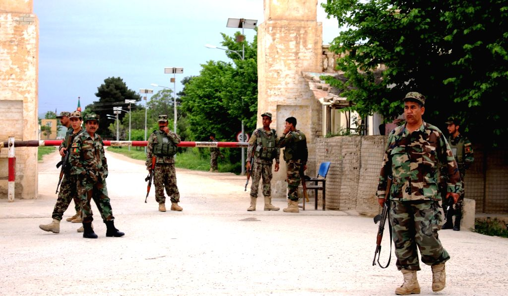 MAZAR-I-Afghan army soldiers stand guard in front of the army corps gate in Balkh province, Afghanistan, on April 21, 2017. At least eight military personnel and ...