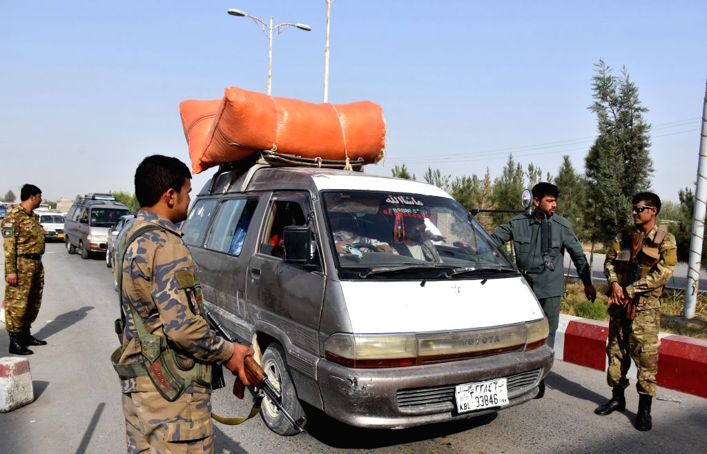 MAZAR-I-Afghan security force members stand guard at a security checkpoint ahead of the upcoming presidential election in Balkh province, northern Afghanistan, ...
