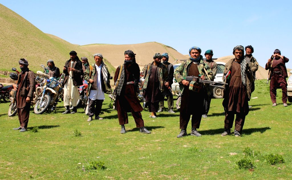 MAZAR-I-SHARIF, April 2, 2017 (Xinhua) -- Armed men attend a surrender ceremony in Chimtal district, Balkh province, Afghanistan, April 1, 2017. More than 200 rebels affiliated with the Taliban group laid down arms and surrendered to the government i