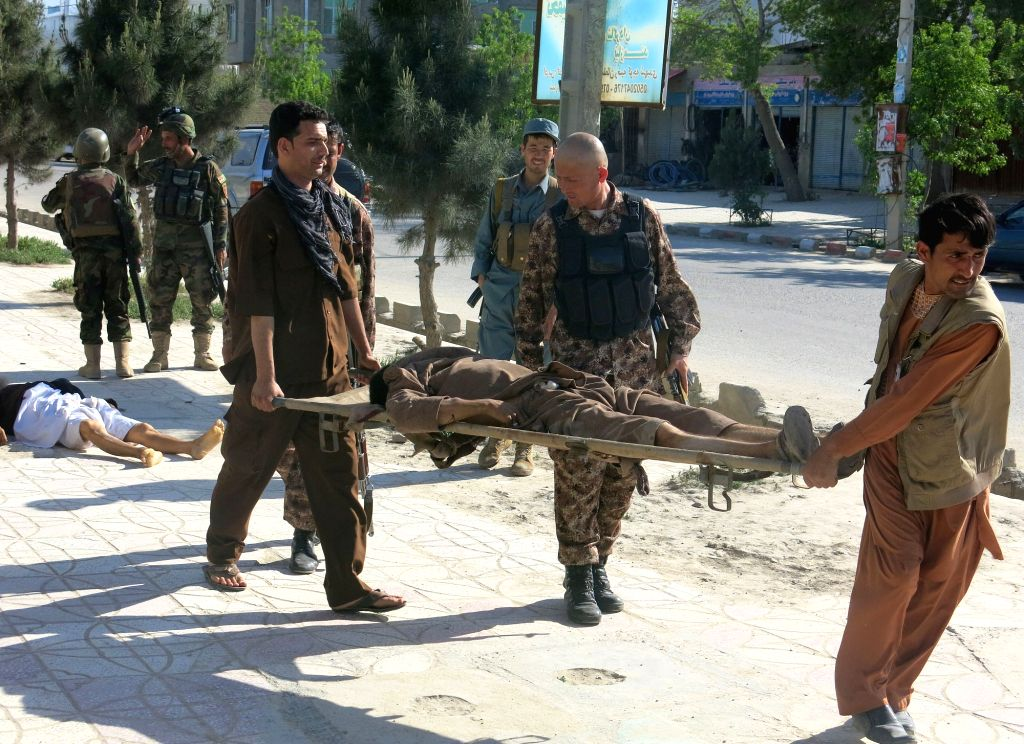 MAZAR-I-Afghan security members carry the body of a victim at the site of an attack in Mazar-i-Sharif city, the capital of northern Afghan province of Balkh, on ...
