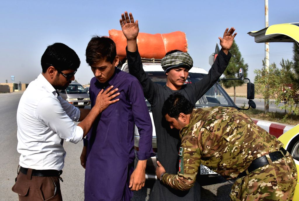 MAZAR-I-SHARIF, Sept. 26, 2019 (Xinhua) -- Afghan security force members work at a security checkpoint ahead of the upcoming presidential election in Balkh province, northern Afghanistan, Sept. 26, 2019. More than 9 million eligible voters are expect