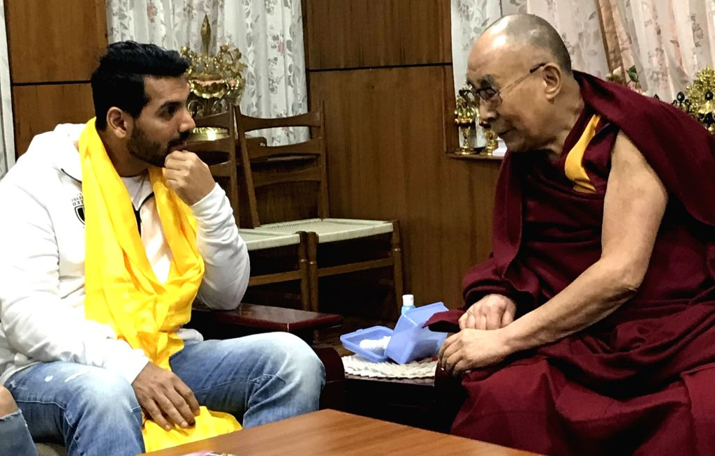 McLeod Ganj: Actor John Abraham calls on Tibetan spiritual leader the Dalai Lama at his palace in McLeod Ganj, Dharamahala on Dec 5, 2017. - John Abraham