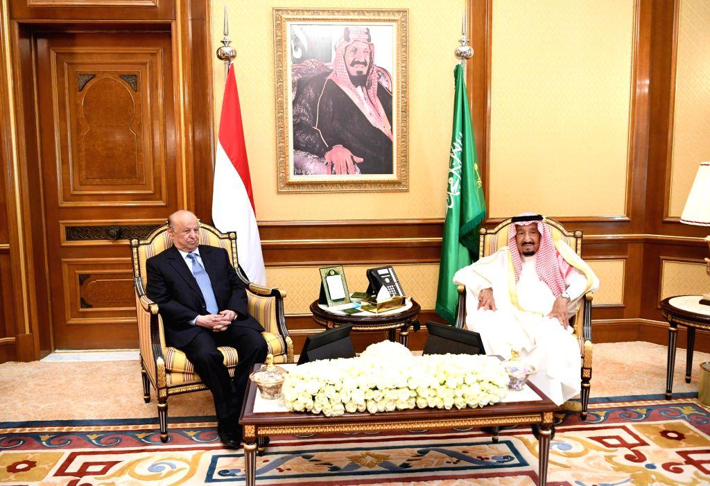 MECCA, Aug. 11, 2019 - Saudi King Salman bin Abdulaziz Al Saud (R) meets with Yemen's President Abdu-Rabbu Mansour Hadi in Mecca, Saudi Arabia, on Aug. 11, 2019. Yemen's President Abdu-Rabbu Mansour ...