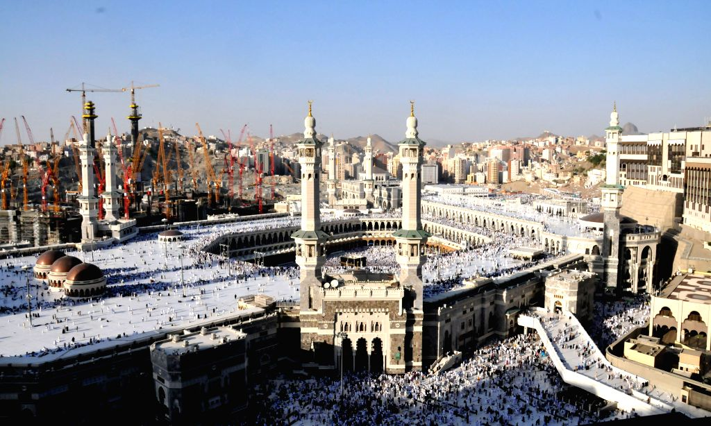MECCA, Sept. 11, 2015 (Xinhua) -- A file photo taken on November 3, 2013 shows an aerial view of the Clock Tower and the Grand Mosque in Saudi Arabia's holy city of Mecca. 87 pilgrims were killed and 201 others were injured when a crane fell on the g
