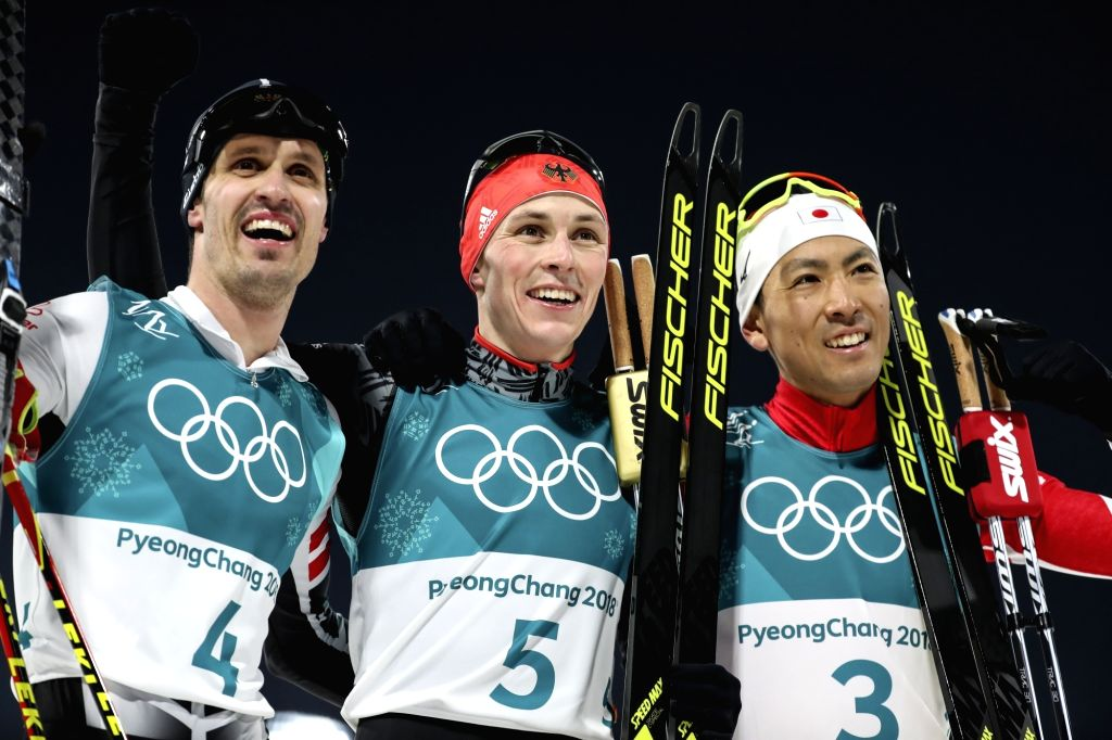 Medalists of individual Gundersen normal hill/10km at PyeongChang Winter Olympics pose for photos after the race at Alpensia Ski Jumping Centre in Pyeongchang, east of Seoul, on Feb. 14, ...