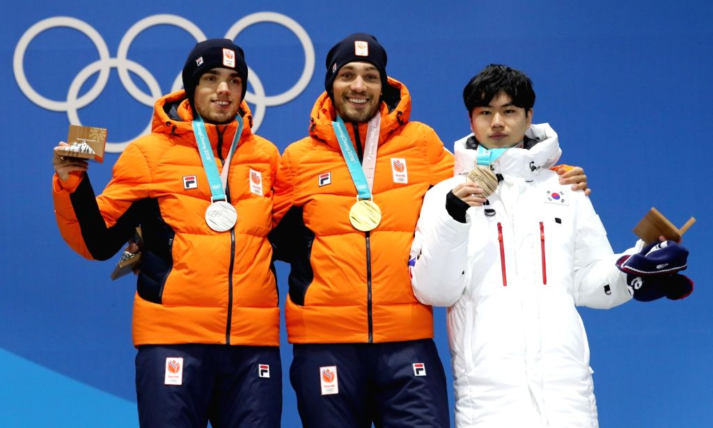 Medalists of men's 1,500-meter speed skating pose for photos at a victory ceremony of the PyeongChang Winter Olympics in PyeongChang, east of Seoul, on Feb. 14, 2018. From left are ...