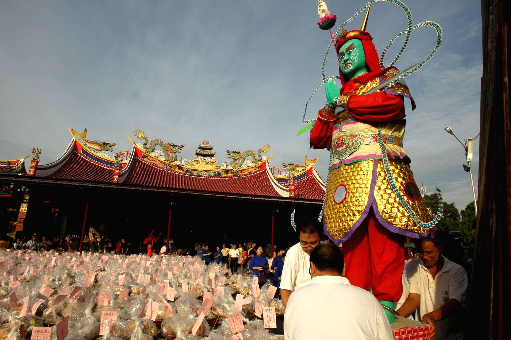 Chinese Indonesians prepare to honor their ancestors during the Hungry Ghost Festival in Medan, North Sumatra, Indonesia, Aug. 10, 2014. The Hungry Ghost Festival is .