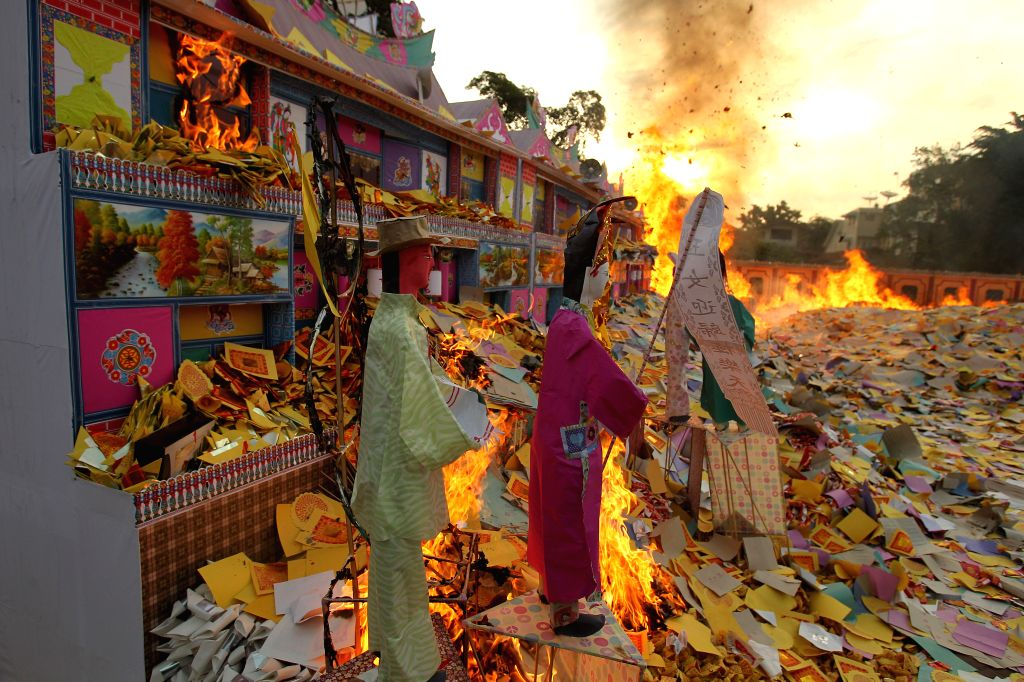 Incense paper is burnt to honor people's ancestors during the Hungry Ghost Festival in Medan, North Sumatra, Indonesia, Aug. 10, 2014. The Hungry Ghost Festival is ...