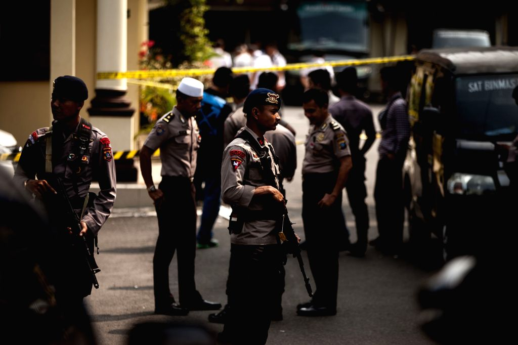 MEDAN, Nov. 13, 2019 - Police officers stand guard at the scene of a suicide bombing at Medan city police headquarters in Medan, North Sumatra, Indonesia, Nov. 13, 2019. A suicide bombing allegedly ...