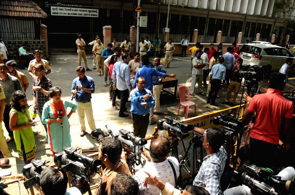 Media persons outside the Bombay City Civil and Sessions Court in Mumbai on Sept 7, 2017.