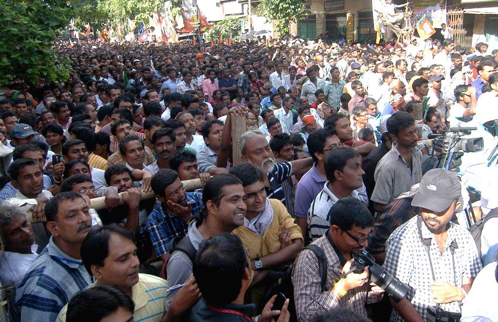 Mediapersons cover a BJP rally in Kolkata on Sept 7, 2014. BJP chief Amit Shah campaigned for Ritesh Tiwari, party's candidate from Chowringhee assembly seat in the rally. - Amit Shah
