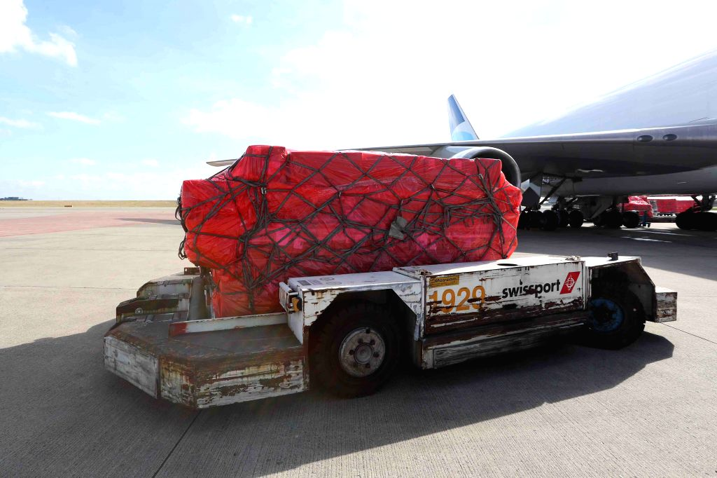 Medical materials from China arrive at the Liege airport in Belgium, on March 18, 2020. A batch of 1 million donated medical masks were flown in Belgium on ...