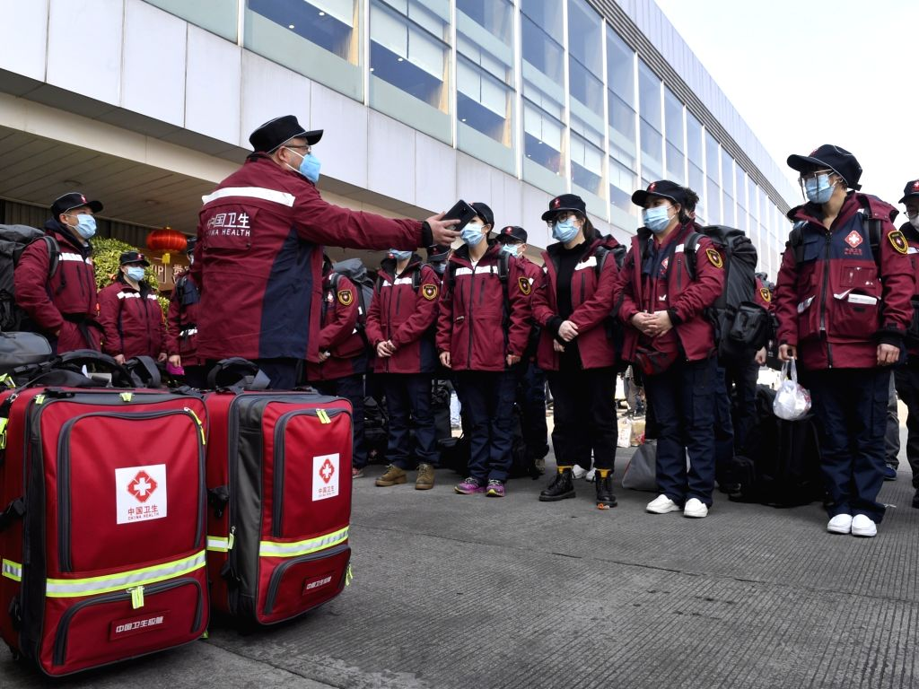 Medical staff assemble before leaving for Wuhan in Chengdu, capital of southwest China's Sichuan Province, Jan. 25, 2020. The first group of 138 medical staff of ...