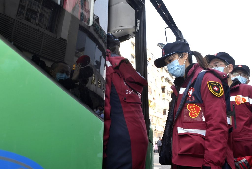 Medical staff get on a bus heading for Chengdu Shuangliu International Airport in Chengdu, capital of southwest China's Sichuan Province, Jan. 25, 2020. The first ...