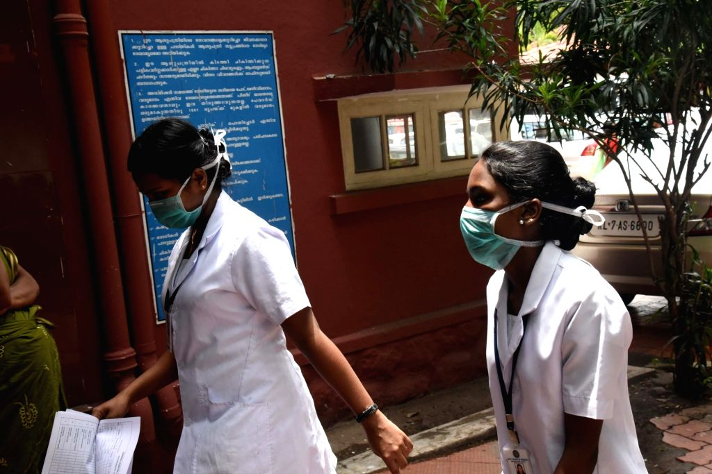 Medical staff seen wearing masks at Ernakulam General Hospital. Kerala Health Minister K.K.Shailaja confirmed that the blood reports of a youth, suspected to be infected by the Nipah virus ... - K.