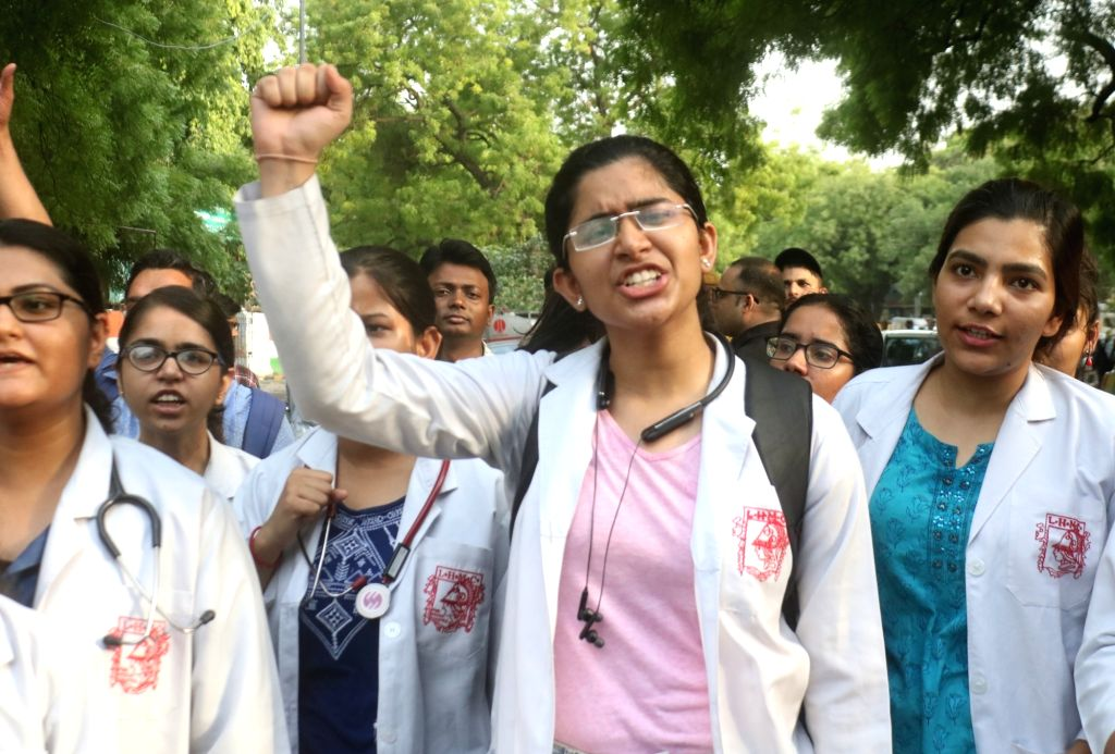 Medical students stage a demonstration against the recent attacks on doctors in Kolkata; in New Delhi on June 13, 2019.