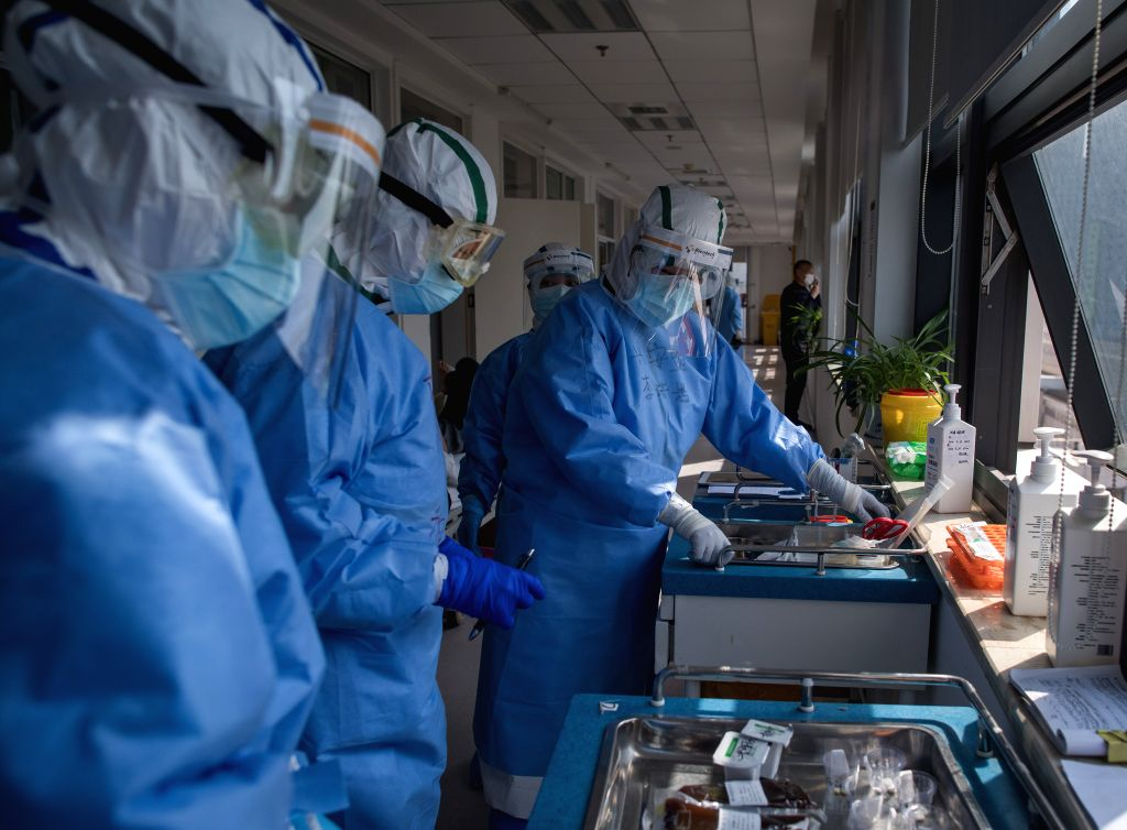 Medical workers from north China's Inner Mongolia Autonomous Region work at the Wuhan pulmonary hospital in Wuhan, central China's Hubei Province, March 19, 2020. As ...