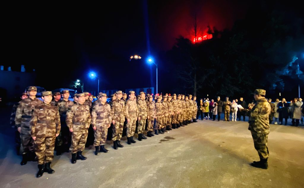 Medical workers of Army Medical University assemble before leaving for Wuhan in southwest China's Chongqing, Jan. 24, 2020. On the Chinese Lunar New Year's Eve, a ...