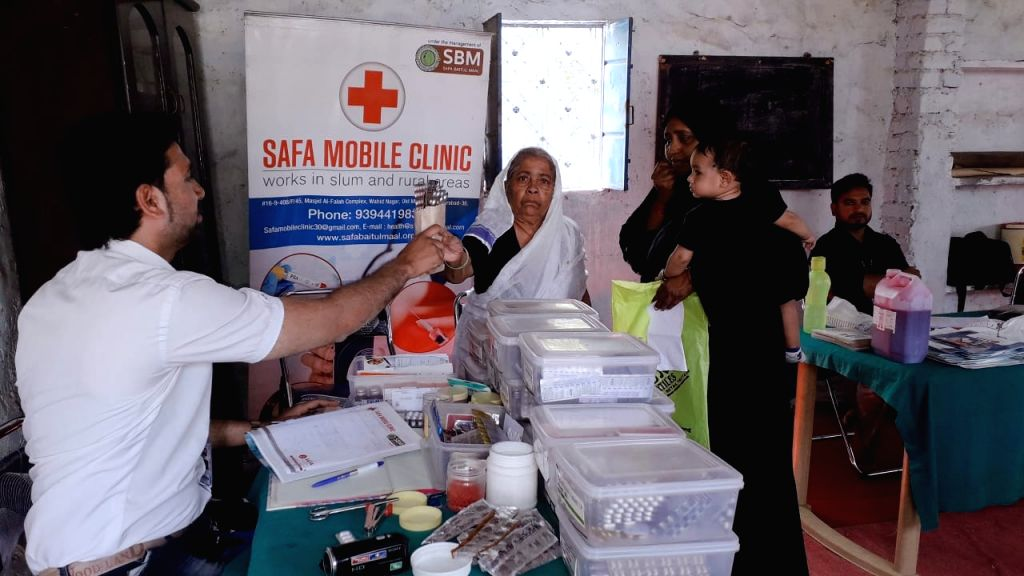 Medicines being given to the needy.